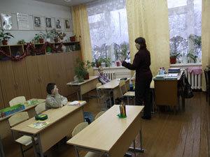 Занятие в первом классе 3 ученика.